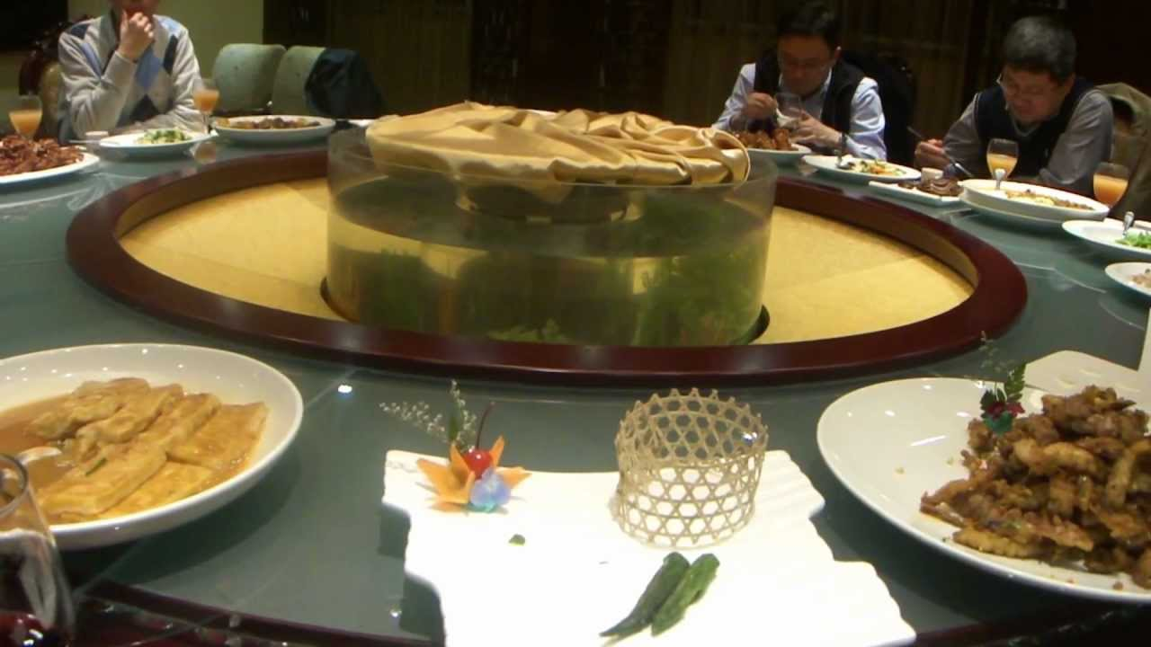 An Extravagant Chinese Dinner On Rotating Table In Dalian, China