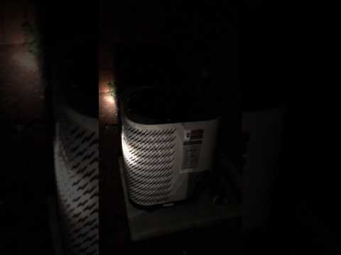 Why is my out door ac unit make woo woo noise?