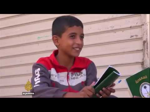 Children attend underground school in Syria's Aleppo