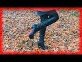 Walking in boots with high heels over fallen leaves and mud in the forest
