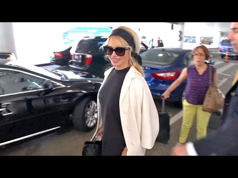Pamela Anderson Looking Happy At LAX After Cosying Up To Cheryl Cole's Ex In Cannes thumbnail
