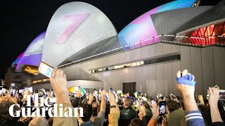 Protesters shine torches on Sydney Opera House to disrupt horse racing ad