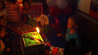 Jesse Bostrom blowing out candles on birthday cake