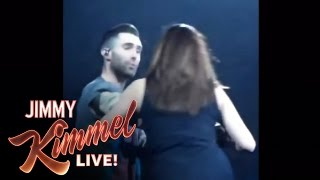 Repeat youtube video Adam Levine Accidentally Threw A Mic In A Fan's Face