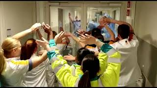 Hospital workers cheer and sing for colleagues on the frontline