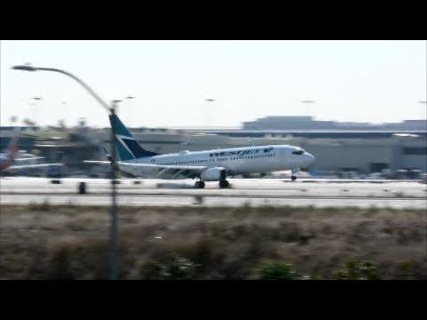 Los Angeles  Airport ,  west jet landing on runway 24L Boeing 737/800