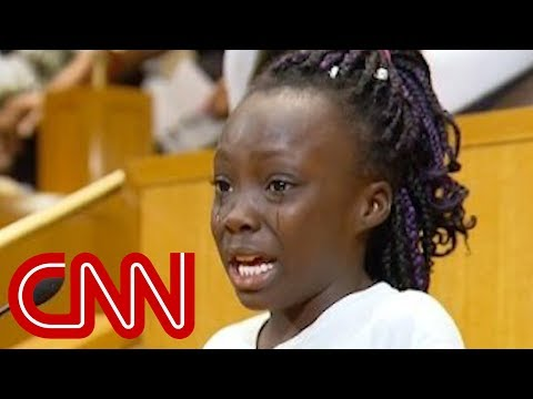 Girl weeps over police shootings