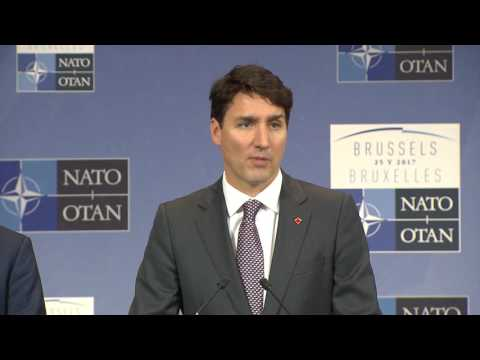 Canadian PM Press Conference at Meeting of Heads of State at NATO HQ