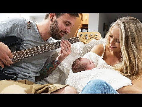 FATHER PLAYS GUITAR TO BABY FOR THE FIRST TIME