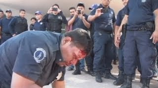 Punches and kicks as striking Mexican police fight other officers in Villahermosa