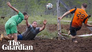 Swamp soccer: footballers battle it out in mud for World Cup spot