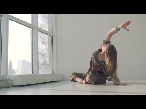 Young Calm Woman Doing Yoga in Well-lit Studio   Stock Footage