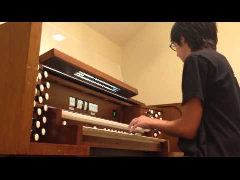 Playing on a Practice Organ at the Lamont School of Music