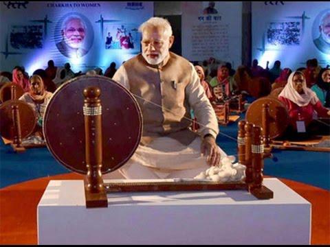 PM Narendra Modi spins charkha