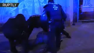 Police scuffle with counter-protesters at march commemorating victims of 1945 Magdeburg bombing