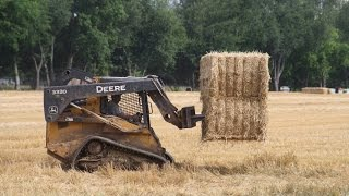 Deere 333D Skid Steer Loader on Tracks Picking Up Big Bales