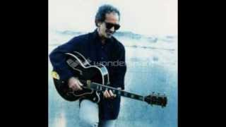 Watch JJ Cale Roll On Mama video