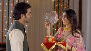 Young Indian couple happily performing Karwa Chauth traditions in traditional wear
