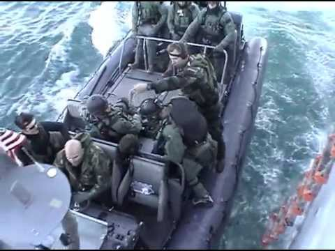 Navy SEALs Training At Sea