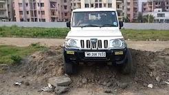Mahindr Bolero 4WD Crossing an obstacle