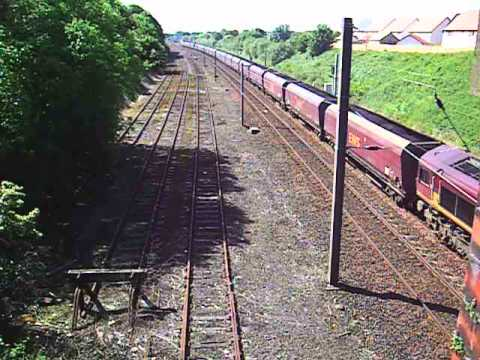 Just out of Hunterston,a fully loaded EWS coal train leaves Kilwinning circa 2009
