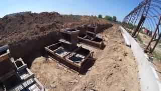 видео: Строительство каркасного ангара. Фундамет и монтаж ферм