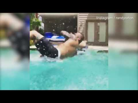 Pro-wrestler Randy Orton Blindsides His Son In Home Pool With RKO