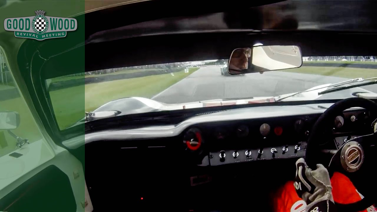 Legendary Kenny Bräck muscles mighty GT40 round soaking wet Goodwood