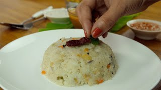 Popular South Indian vegetable Upma served in a ceramic white plate - food concept