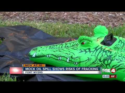 Group puts on mock oil spill to protest fracking