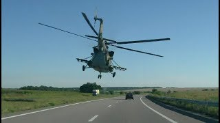 helicopter-flying-past-cars