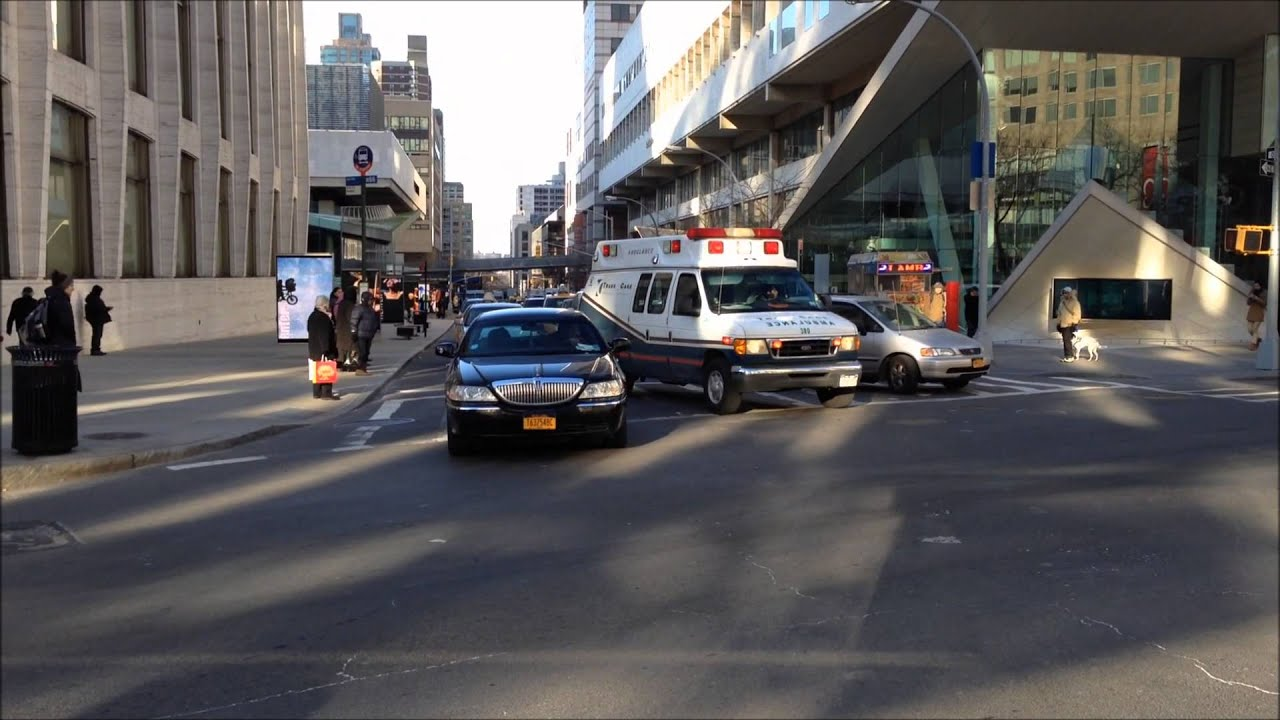 TRANSCARE EMS AMBULANCE RESPONDING ON WEST 65TH STREET AND BROADWAY THE SIDE NYC