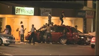 michael-brown-shooting-aftermath-liquor-store-gets-robbed-video