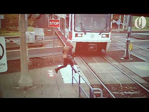 Video shows woman running in front of MAX train