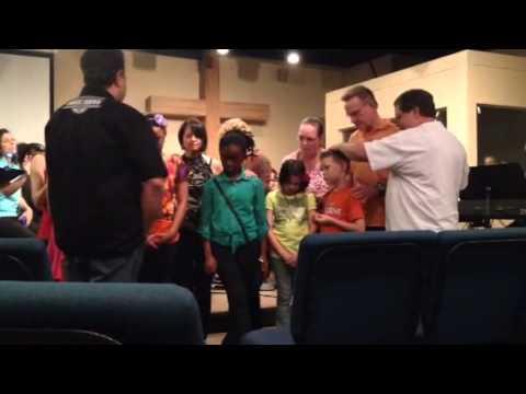 Director of Ihop Jax praying over the children
