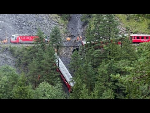 Swiss Train carrying 200 passengers derails after landslide on mountain