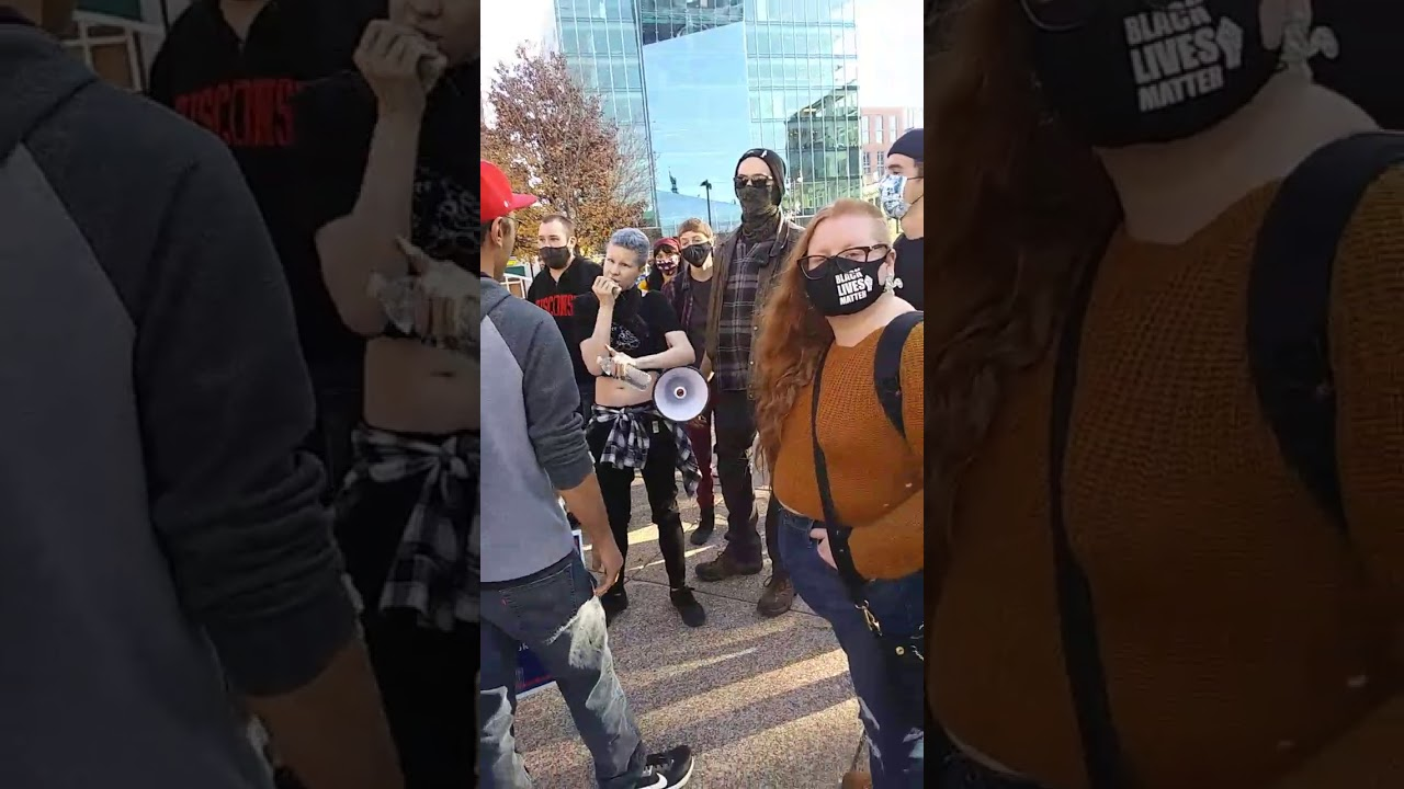 """YOU'RE ON STOLEN LAND!""  Neon Haired Leftist Psycho Bellows Into Megaphone @ Madison"