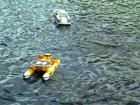 RC rescue boat retreiving another boat - YouTube