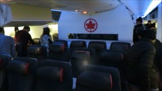 Air Canada B 777-200 LR YYZ - BOM Premium Economy review plus deicing and lounge