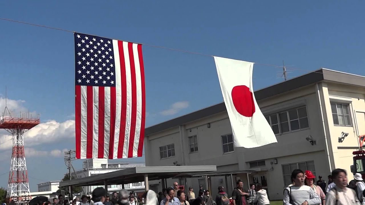 american and japanese flags are waving in cozy breeze
