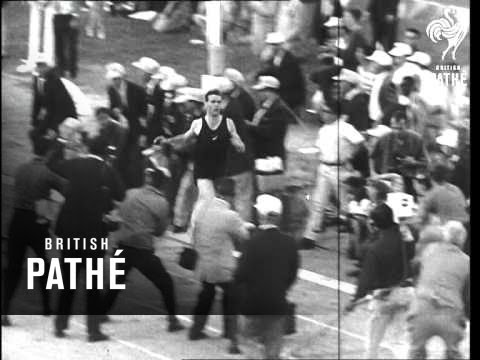 Athletic Meeting In Us Features Beatty Versus Snell In The Mile Event (1963)
