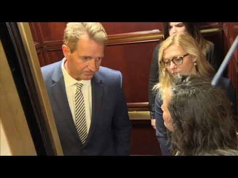 After Sen. Jeff Flake, R-Arizona, announced plans to vote for Brett Kavanaugh's nomination to the Supreme Court, he was stopped by protesters in a Capitol Hill elevator.