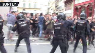 Clashes erupt as cops evict squatters of occupied community center in Spain
