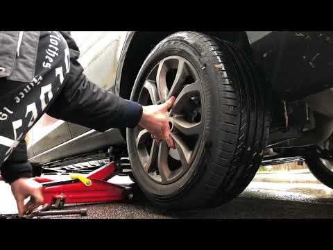 How to replace a rear tire MB C-Class Changing a wheel of a Merceds Benz C180 Sedan Fitting a wheel