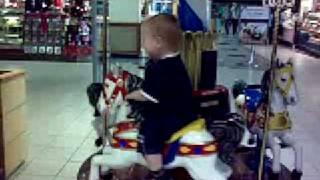Alex's first carousel ride
