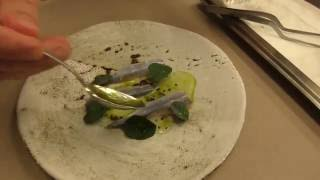 langhoff prepares a signature dish at the michelin star restaurant ask