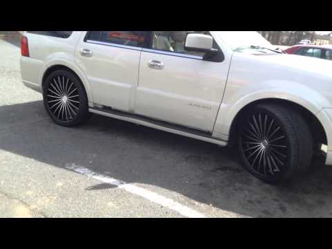 "2006 Lincoln Navigator Rolling out of Rimtyme of Charlotte sitting on 26"" Kronik Kush Rims"