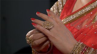 Closeup shot of Indian women in traditional red saree wearing the finger ring