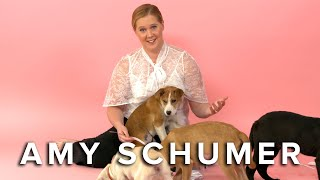 Amy Schumer Plays With Puppies (While Answering Fan Questions)
