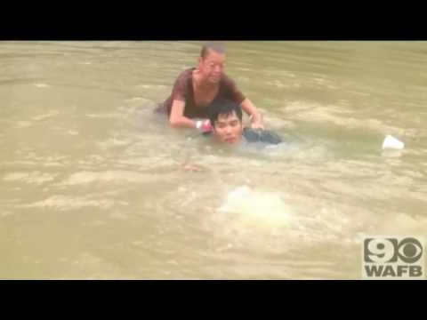 Video: Woman, dog rescued from sinking car in Louisiana flood